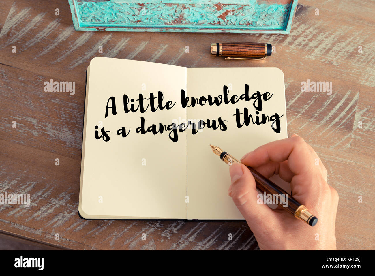 a little learning is a dangerous thing stock photos a little  handwritten quote as inspirational concept image stock image