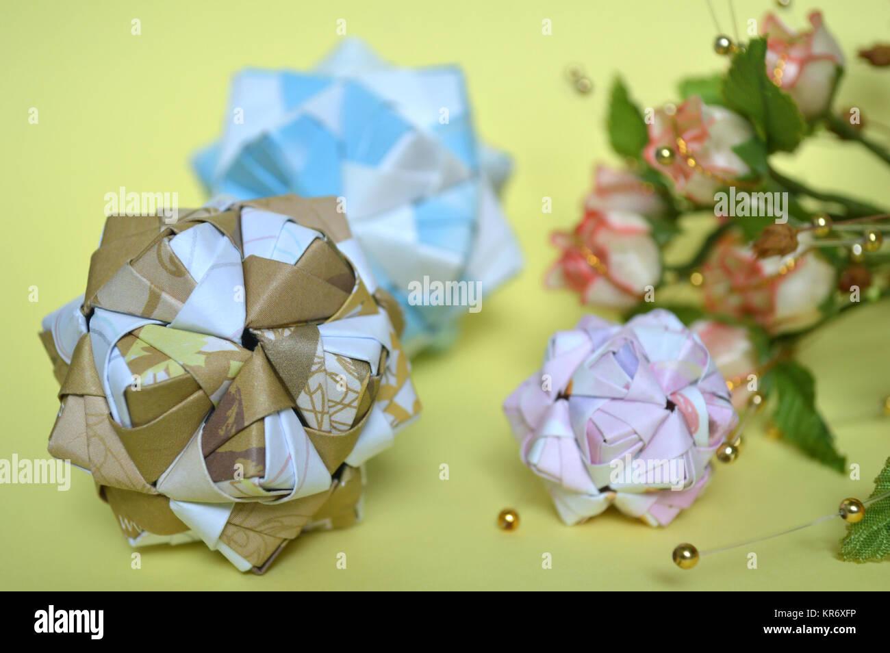 Modular Origami Sonobe Ball On Yellow Background Stock Photo
