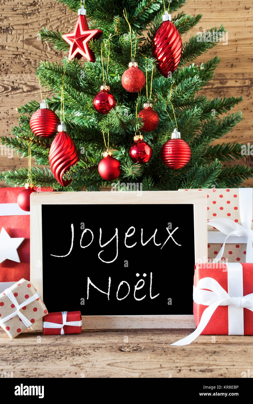 Colorful christmas card for seasons greetings christmas tree with colorful christmas card for seasons greetings christmas tree with balls gifts or presents in the front of wooden background chalkboard with french text kristyandbryce Choice Image