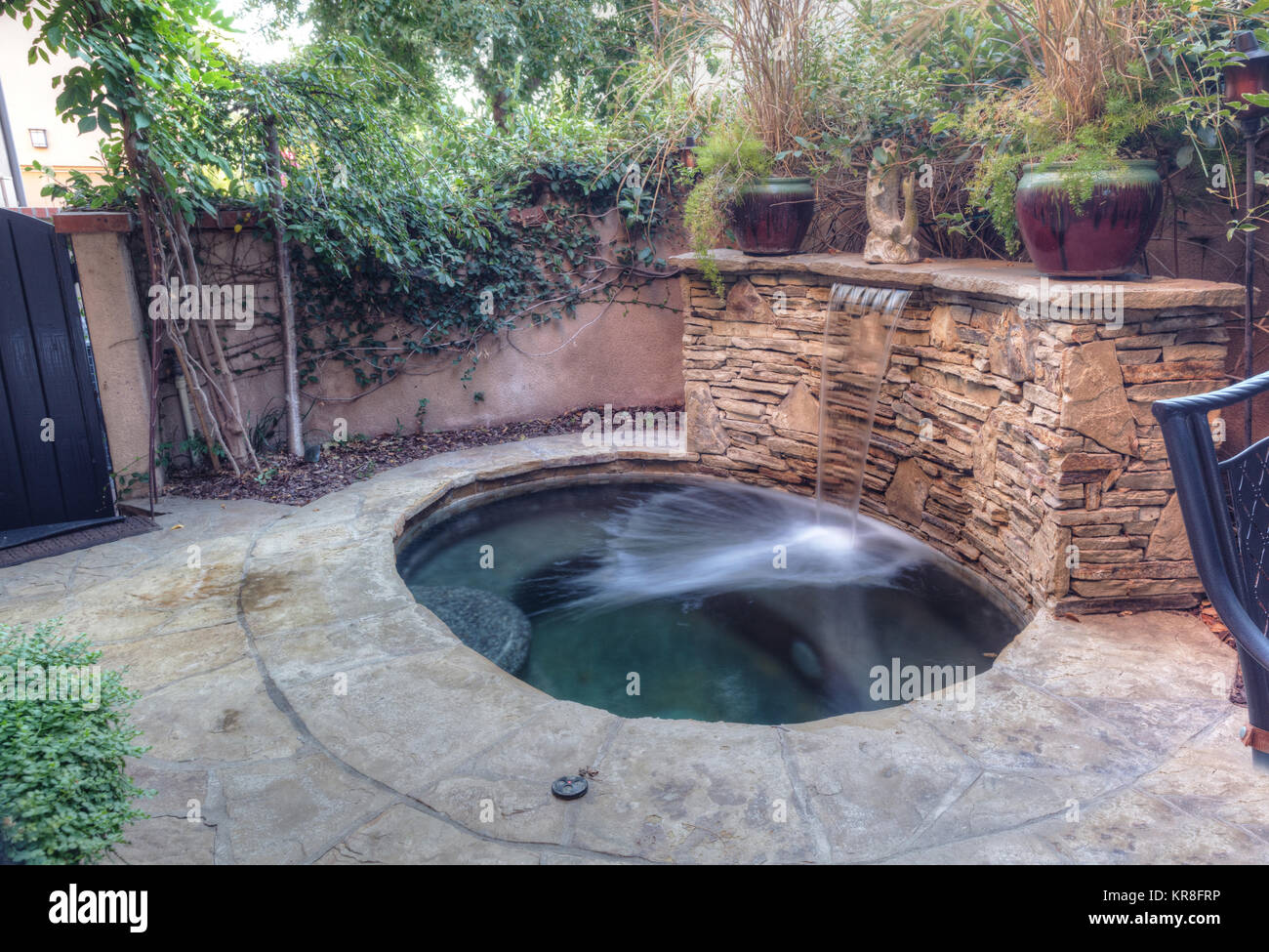 Oval hot tub spa with waterfall Stock Photo, Royalty Free Image ...