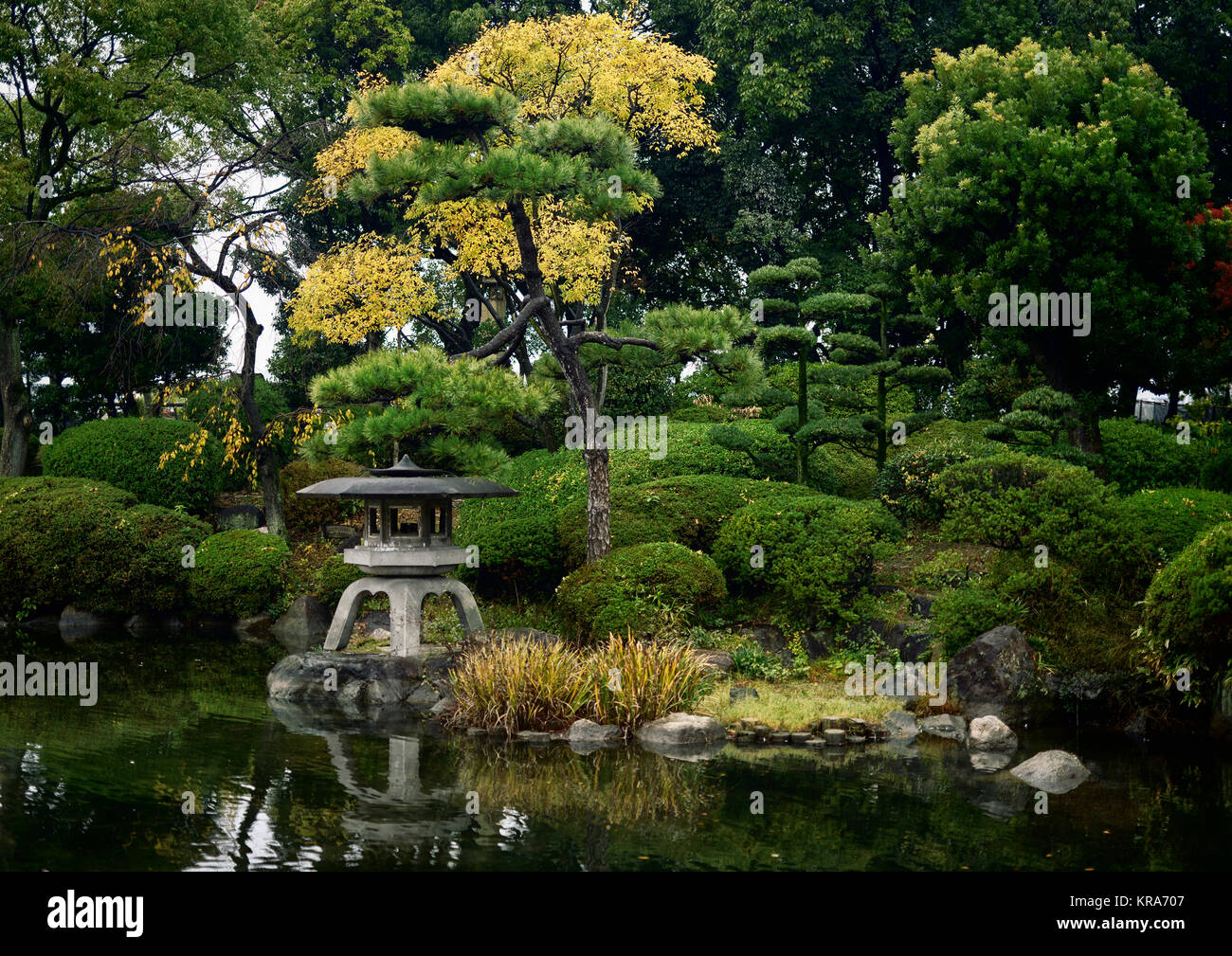 Little japanese zen garden with a lantern and a pond in for Little japanese garden