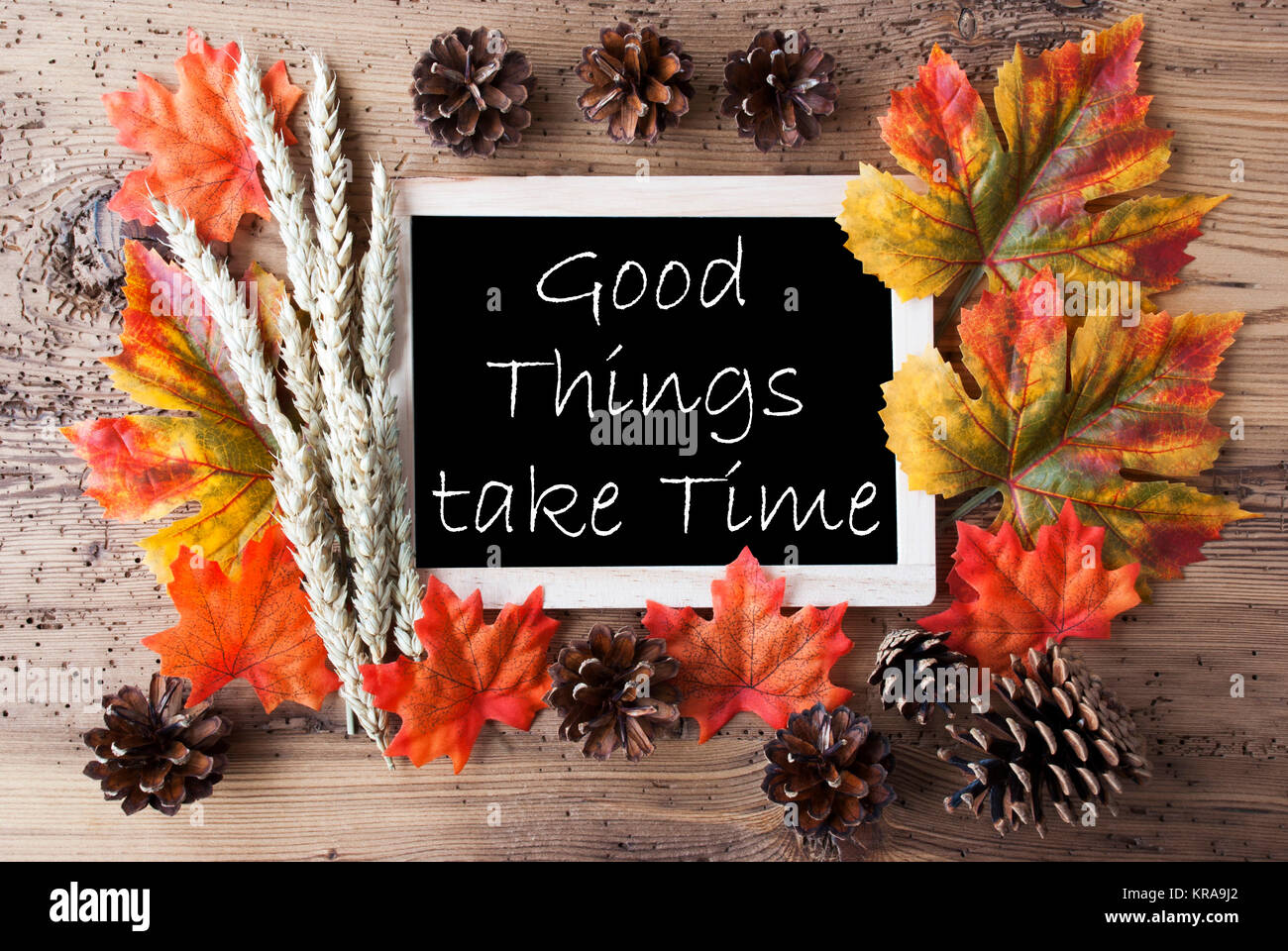 Blackboard With Autumn Or Fall Decoration. Greeting Card For Seasons  Greetings. Colorful Leaves, Fir Cone And Barley On Aged Wooden Background.