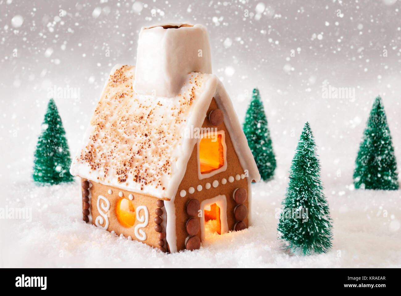 Gingerbread House In Snowy Scenery As Christmas Decoration