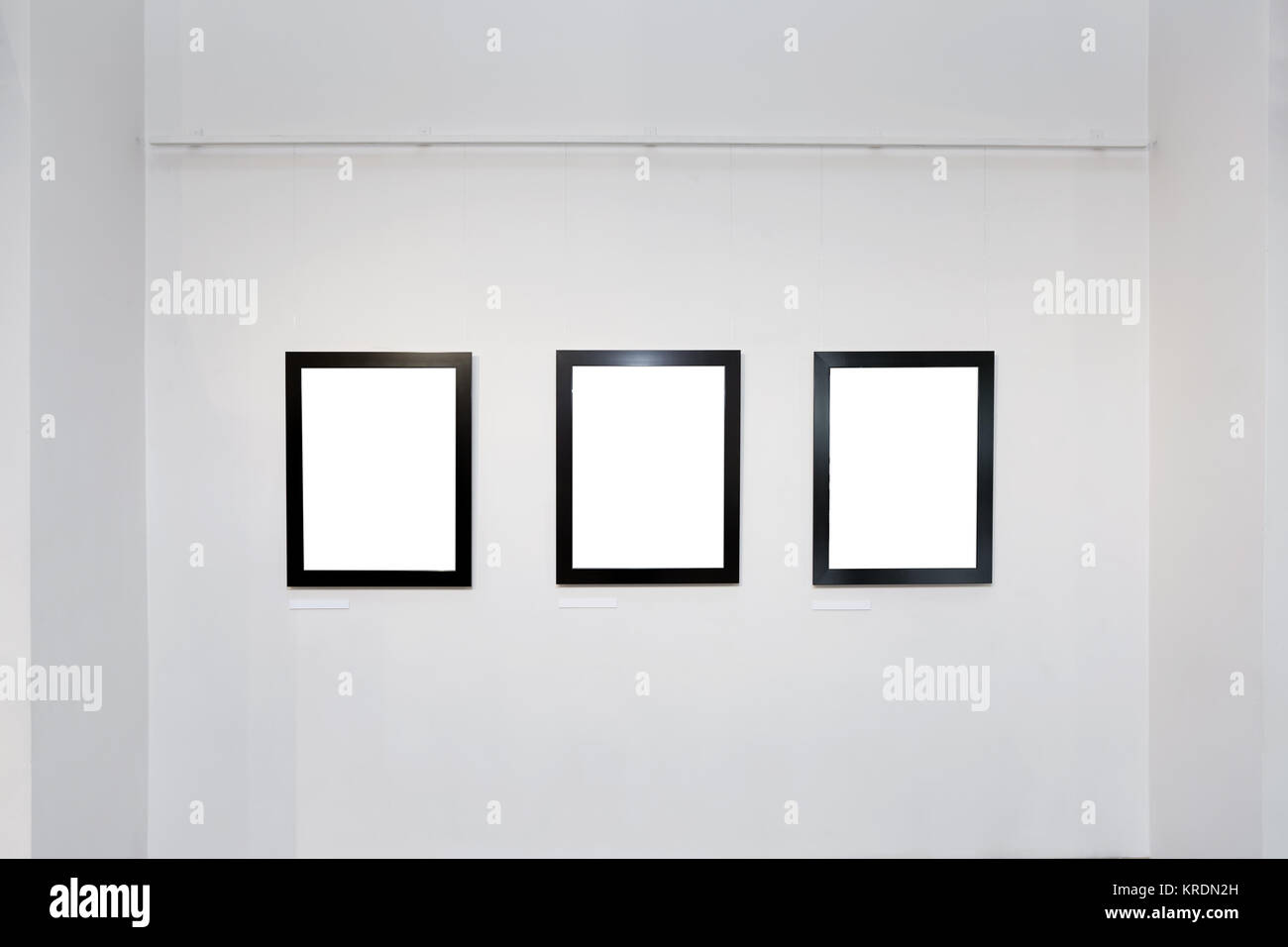 exhibition gallery interior with empty frames on wall - Empty Frames On Wall