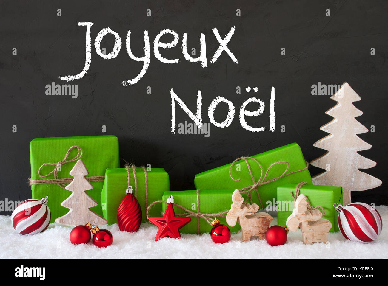 French Text Joyeux Noel Means Merry Christmas. Green Gifts Or Stock ...