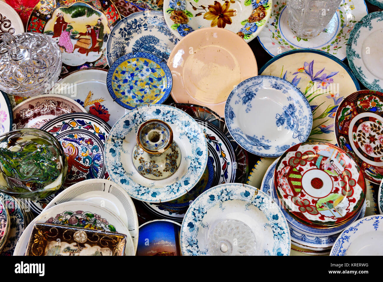 Antique and old plates and dishes on bric-a-brac flea market stall ...