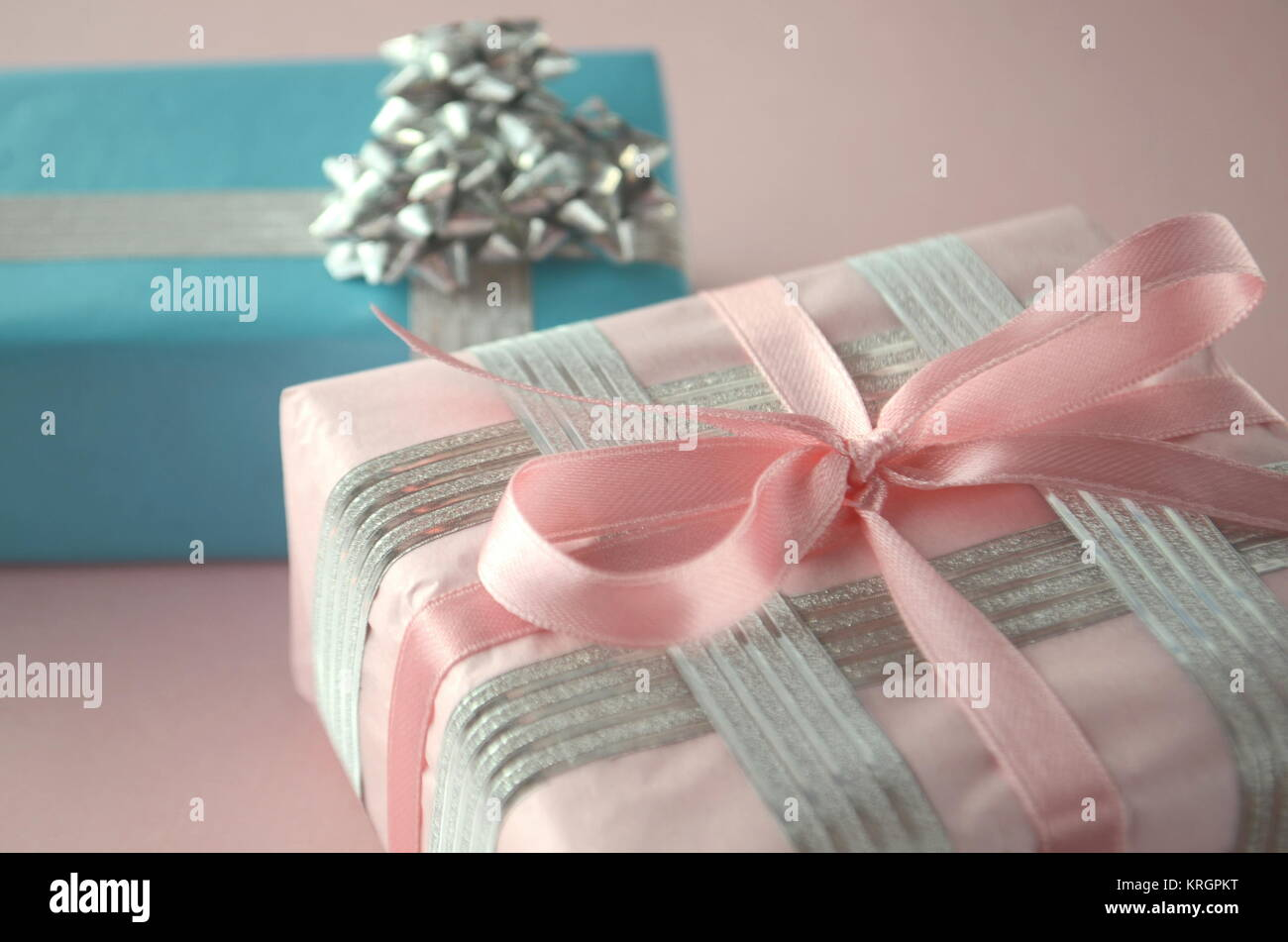 Gift wrapped presents beautiful gift boxes in luxurious wrapping gift wrapped presents beautiful gift boxes in luxurious wrapping paper on clean background with negle Images