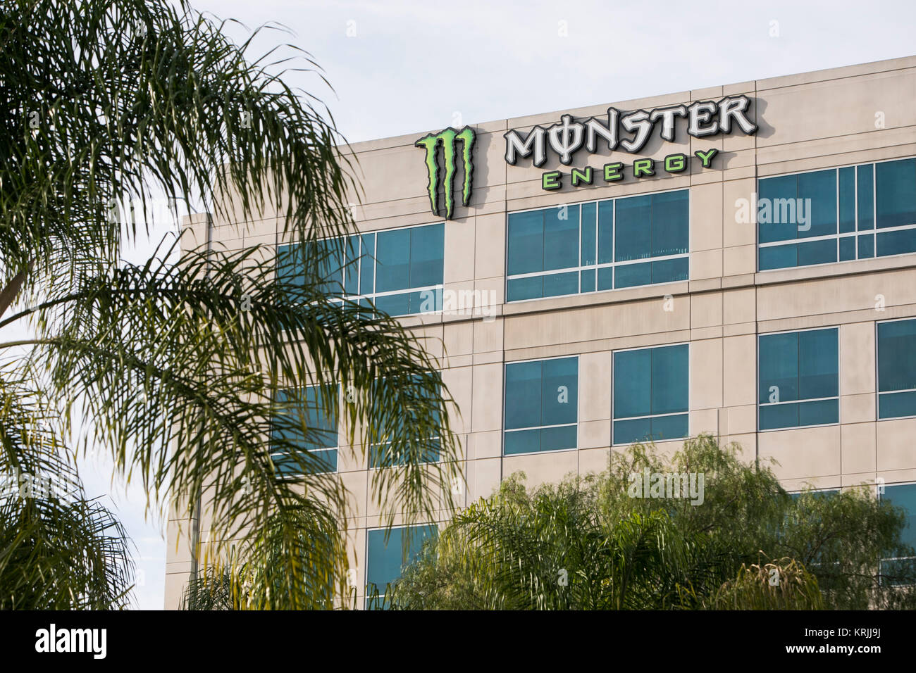 a logo sign outside of the headquarters of the monster beverage