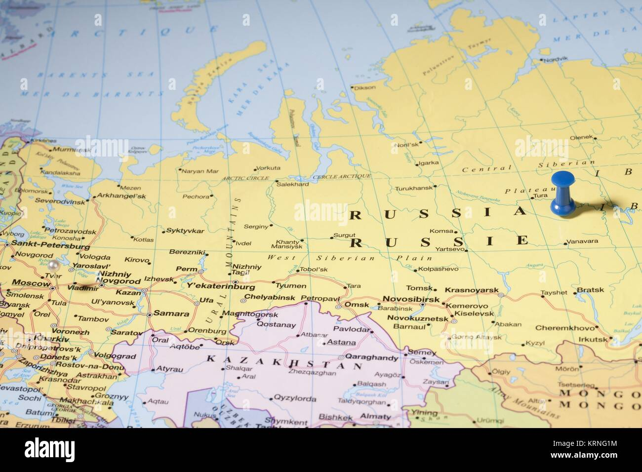 map pins on russian area over world map Stock Photo Royalty Free