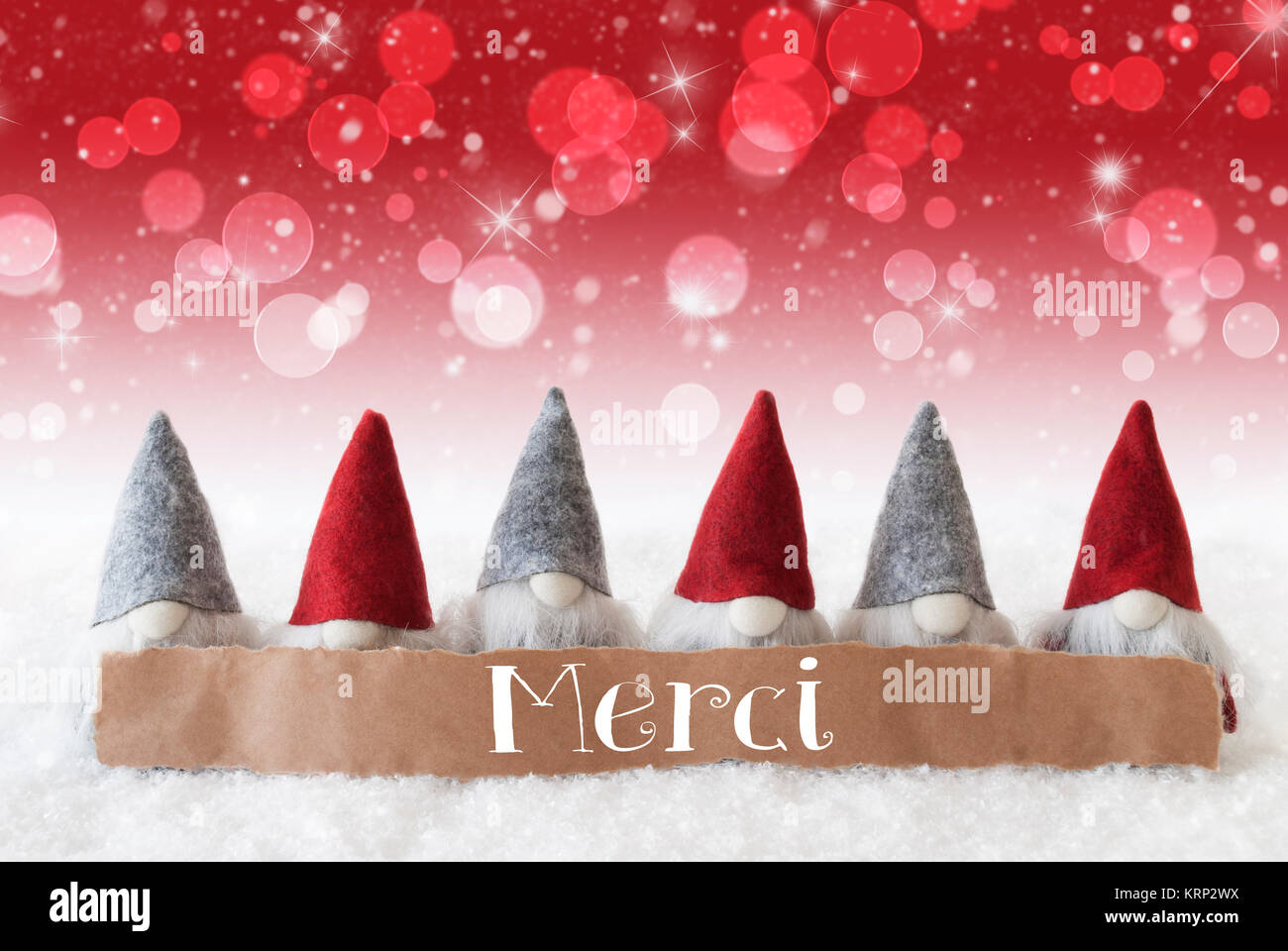 Label with french text merci means thank you christmas greeting label with french text merci means thank you christmas greeting card with red gnomes sparkling bokeh and christmassy background with snow and stars m4hsunfo