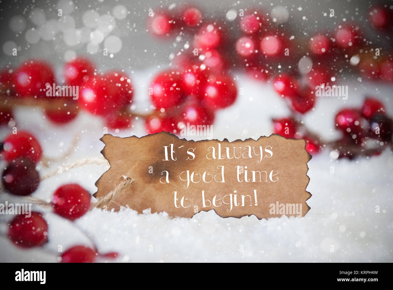 Burnt Label With English Quote It Is Always A Good Time To Begin. Red  Christmas Decoration On Snow. Cement Wall As Background With Bokeh Effect  And ...