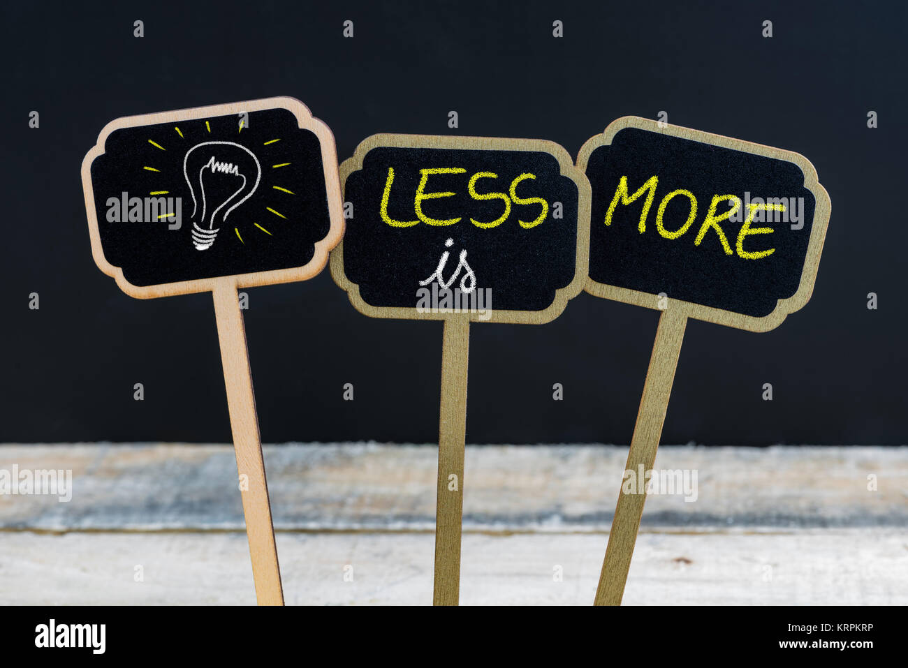 Concept message less is more and light bulb as symbol for idea stock concept message less is more and light bulb as symbol for idea biocorpaavc Images
