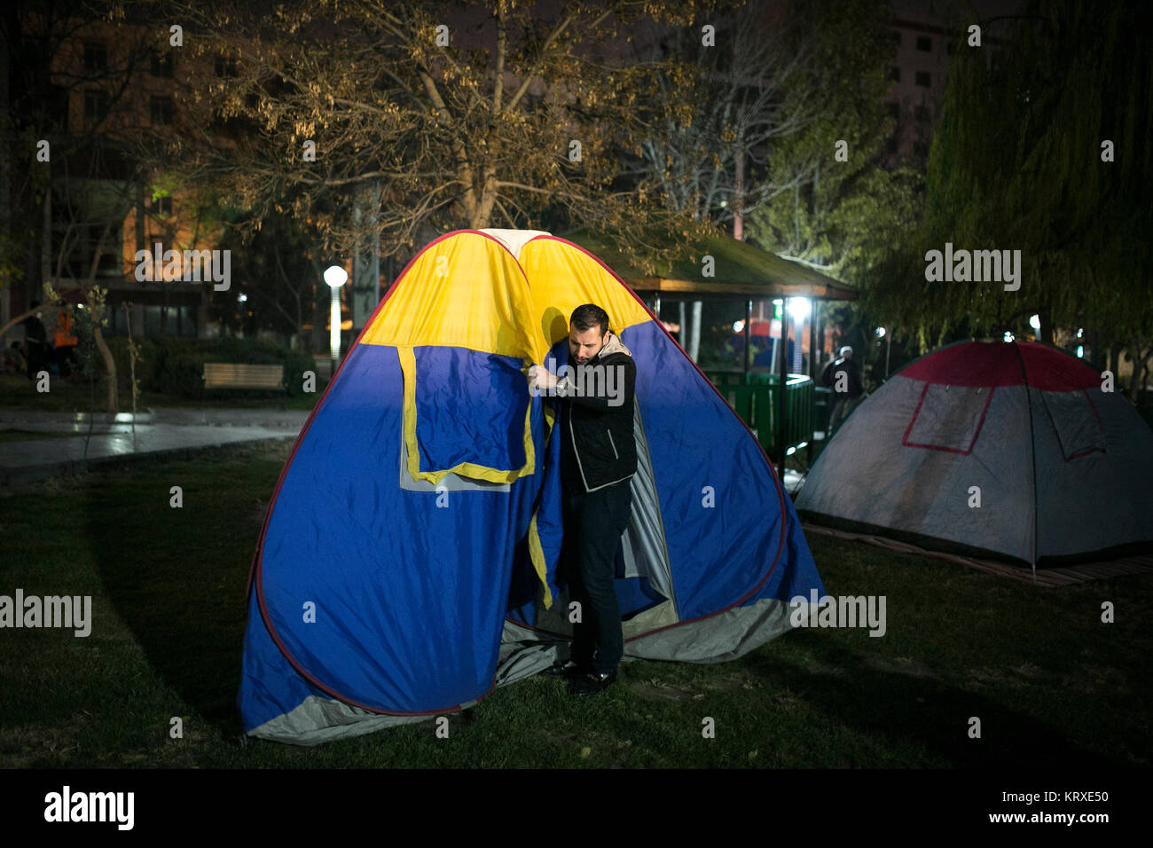 A man sets up a tent at a park after the earthquake in Tehran Iran on Dec. 21 2017. An earthquake measuring 5.2 magnitude on the Richter ... & Tehran Iran. 21st Dec 2017. A man sets up a tent at a park after ...