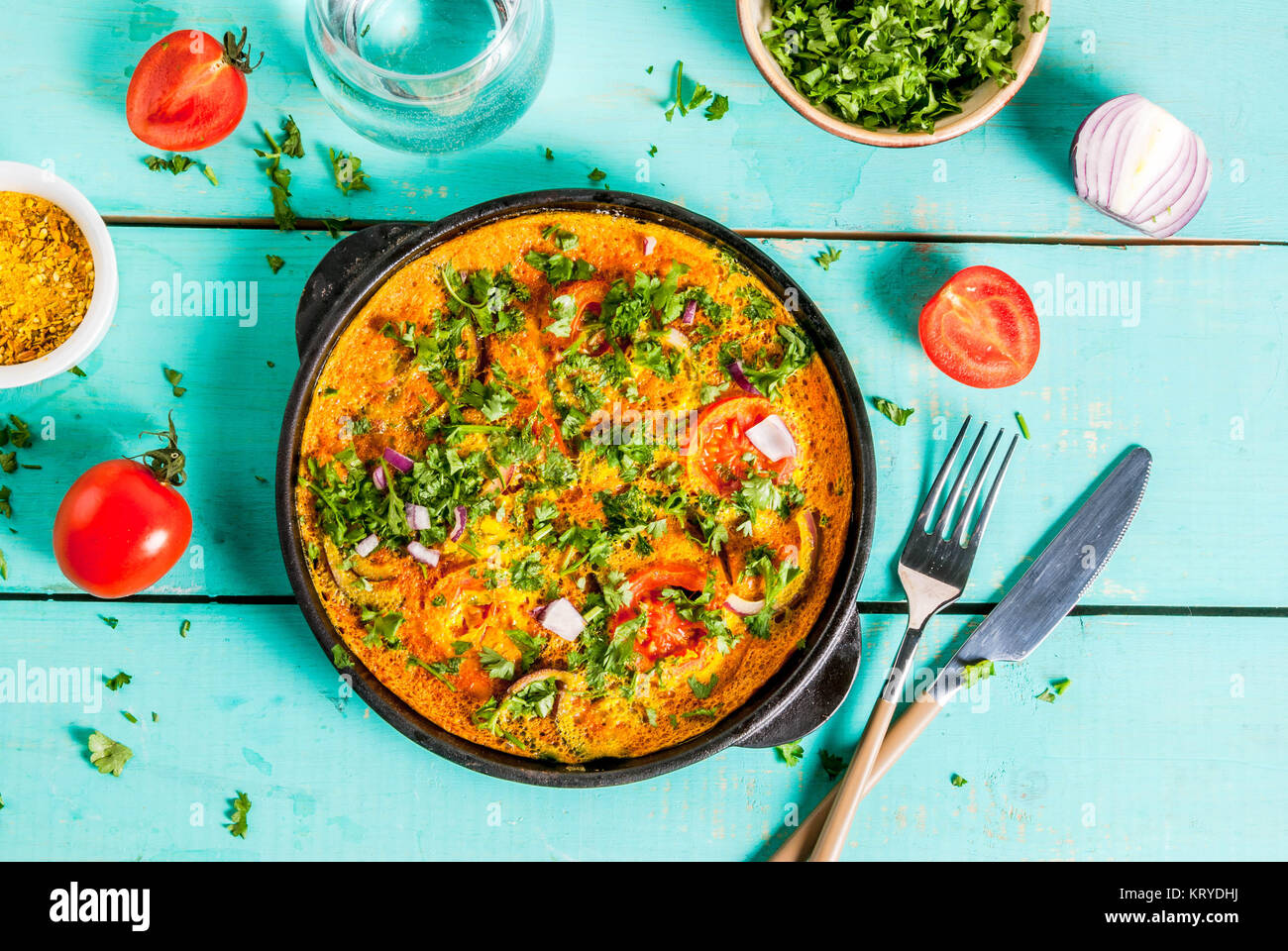 Indian food recipes indian masala egg omelet with fresh vegetables indian food recipes indian masala egg omelet with fresh vegetables tomato hot chili pepper parsley light blue wooden background copy space top forumfinder Images