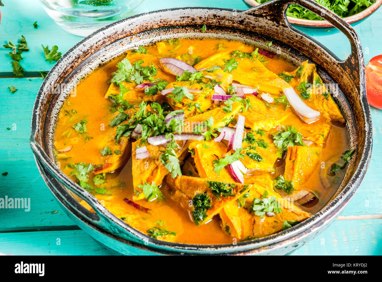 Indian food recipes indian omelet masala egg curry with fresh indian food recipes indian omelet masala egg curry with fresh vegetables tomato hot chili pepper parsley light blue wooden background copy spa forumfinder Images