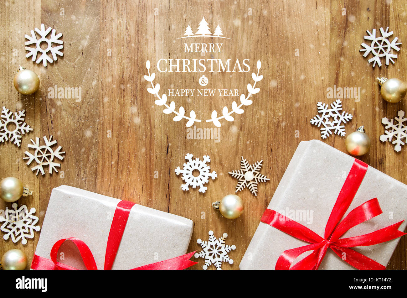 christmas and new year theme background merry christmas and happy new year text on wooden table with gift boxes and decoration