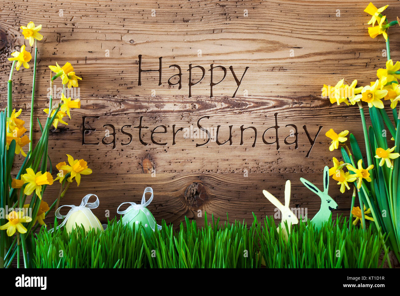 Wooden background with english text happy easter sunday easter wooden background with english text happy easter sunday easter decoration like easter eggs and easter bunny yellow spring flower narcisssus with gras m4hsunfo