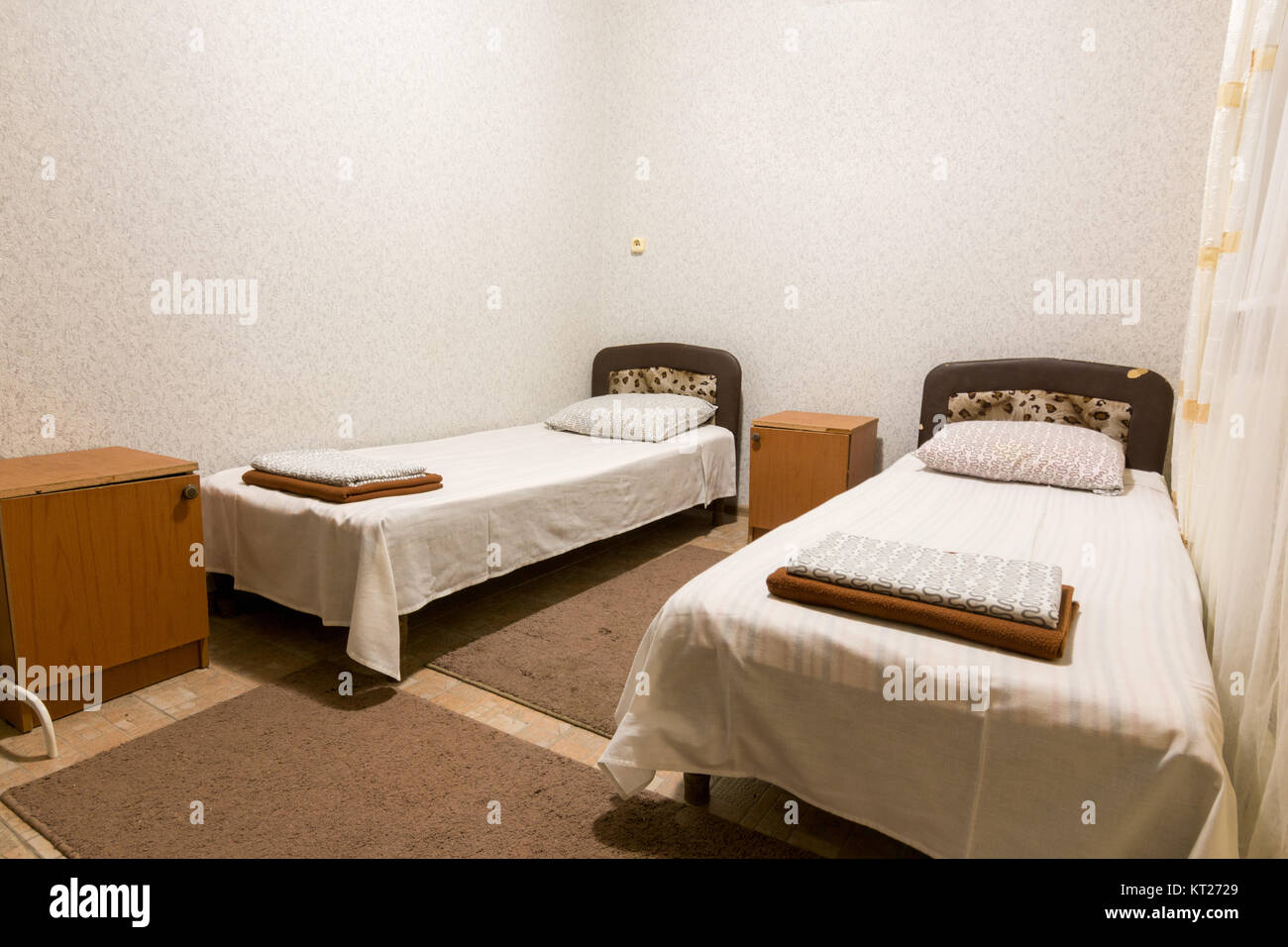 The interior of a small room with two beds Stock Photo ...