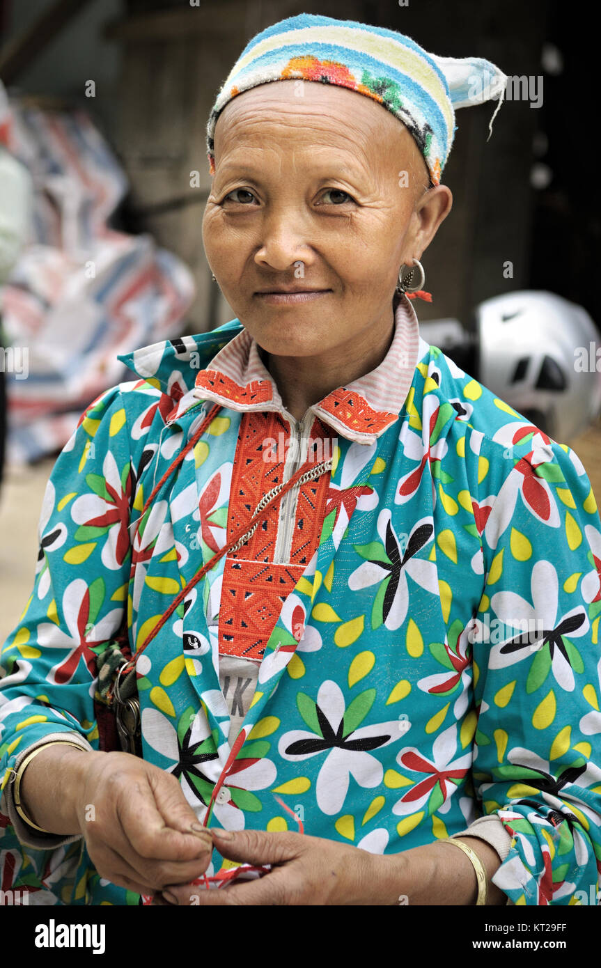 Portrait of a woman with shaved hair and eyebrows in north Vietnam