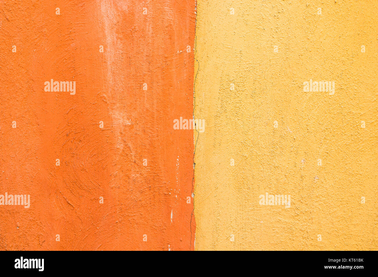Close-up yellow and orange color concrete wall background. texture ...