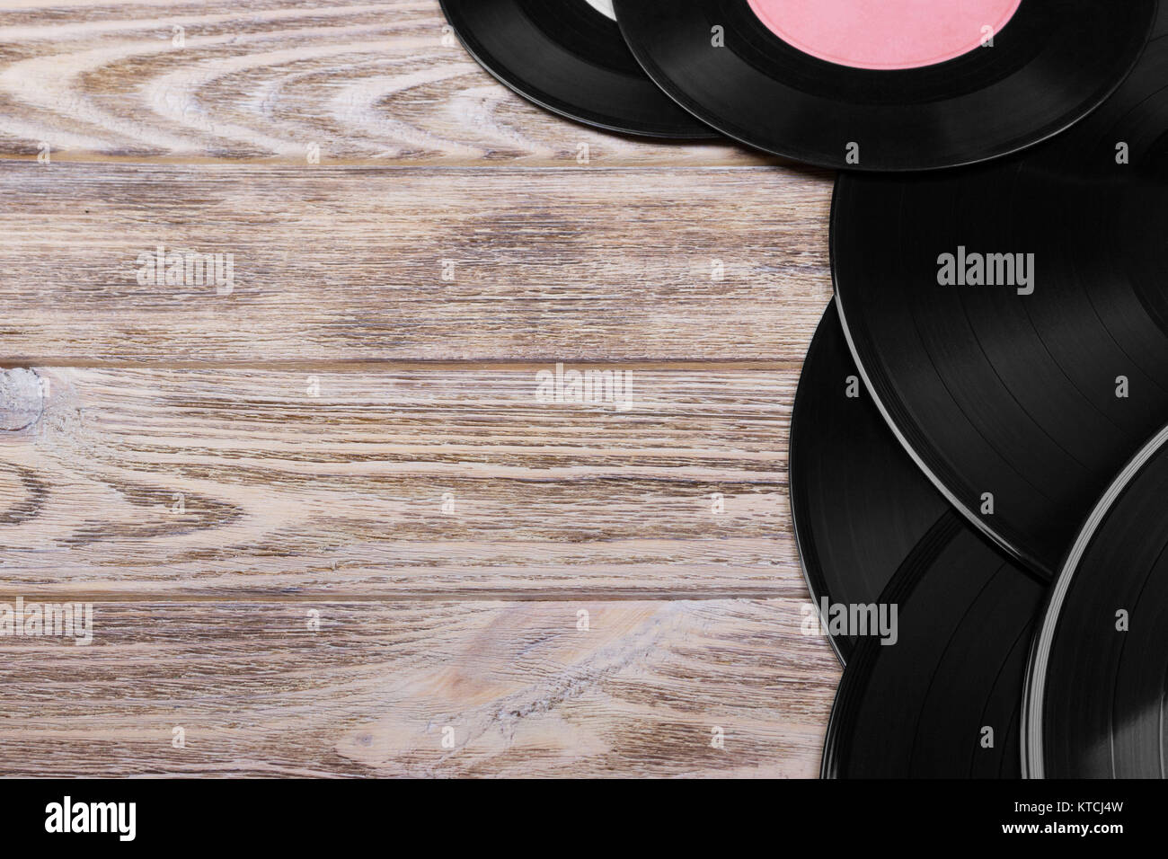 Top View Of Black Vinyl Records On Brown Wooden Background Retro Toned Copy Space