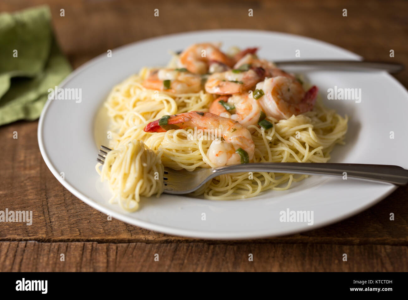 Close Up Shot Of A White Plate Filled With Shrimp Scampi Shrimp