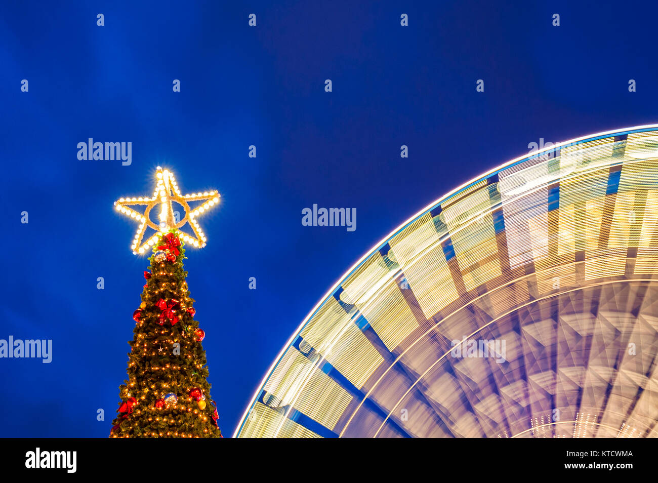 outdoor christmas tree with spinning ferris wheel stock photo