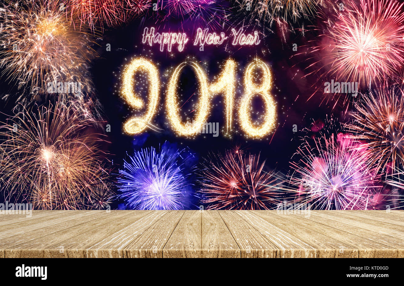 happy new year 2018 fireworks over cityscape at night with empty wood plank table topmock up template for display or montage of product for holiday p
