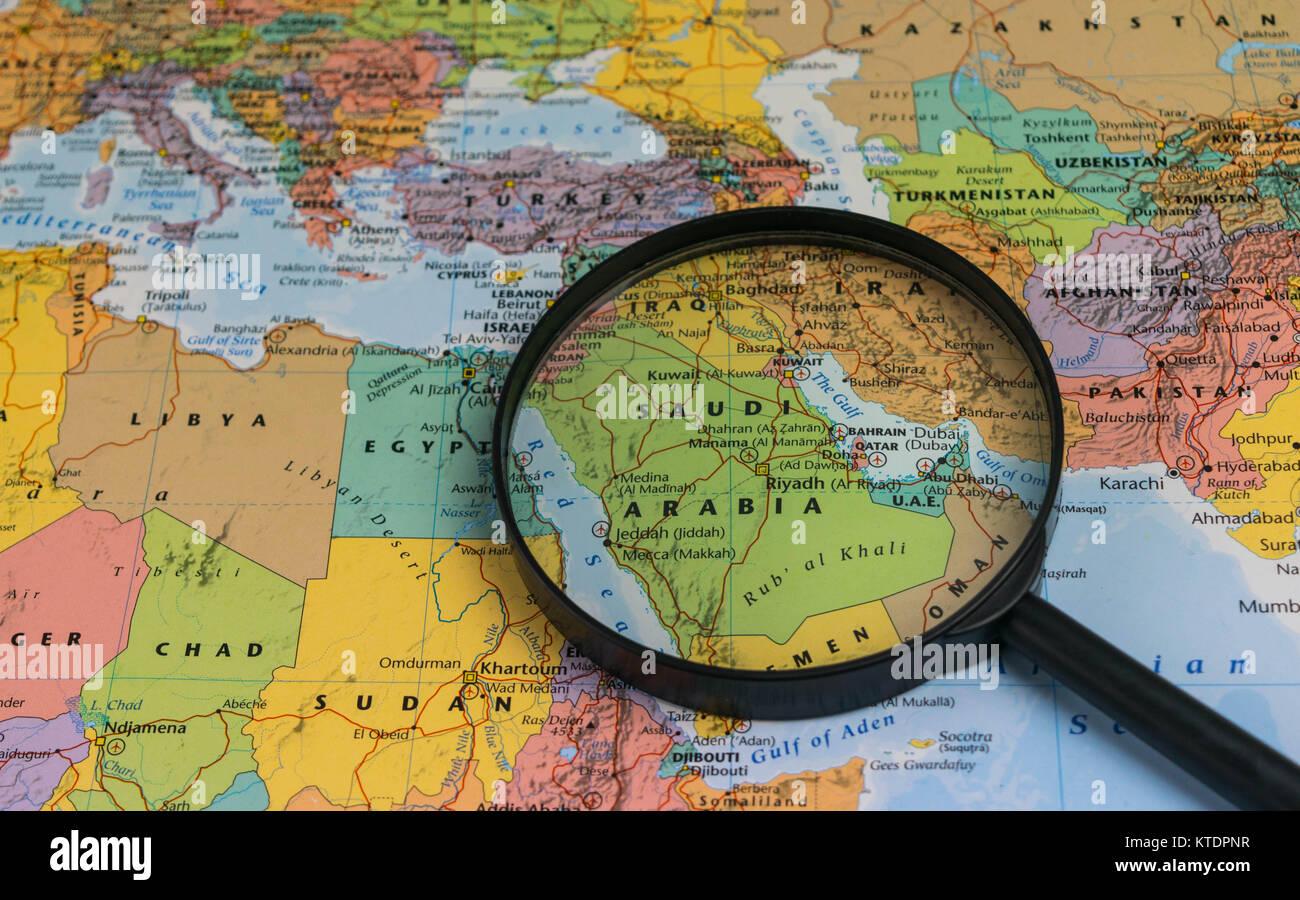 Saudi Arabia map through magnifying glass on a world map Stock Photo ...