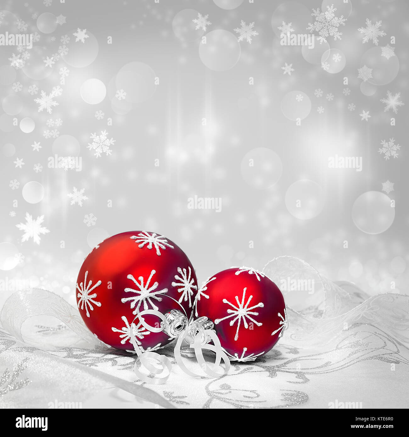 red christmas decorations with silver ornament on neutral winter background text space shallow dof focus on the knot