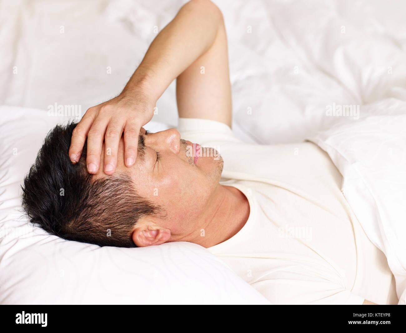 Asian men in bed