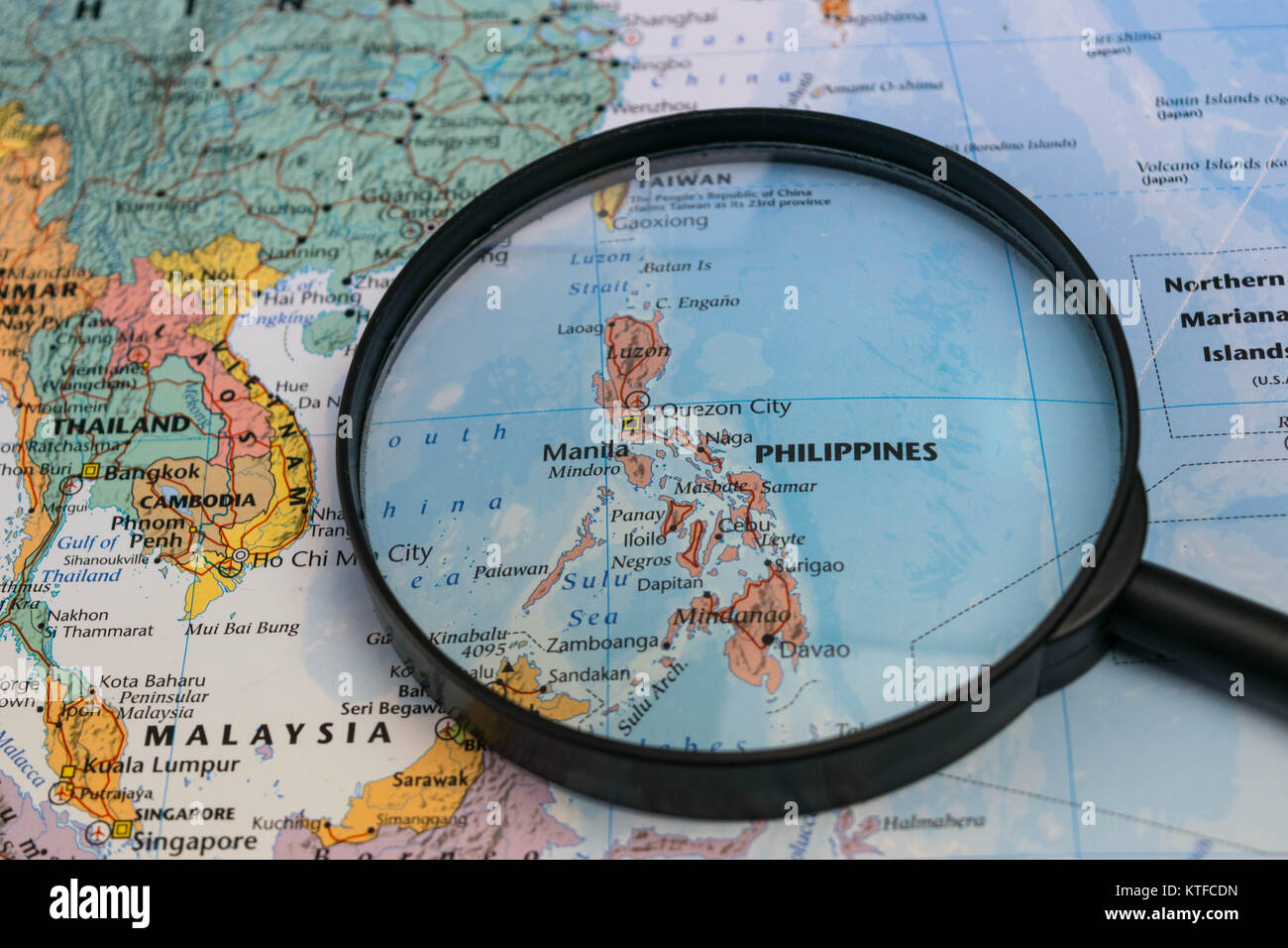 the Philippines map through magnifying glass on a world map Stock ...