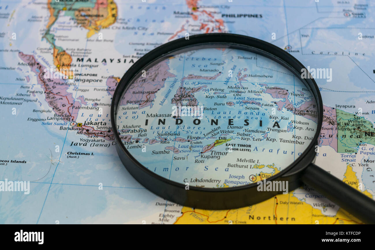 Indonesia map through magnifying glass on a world map stock photo indonesia map through magnifying glass on a world map gumiabroncs Gallery