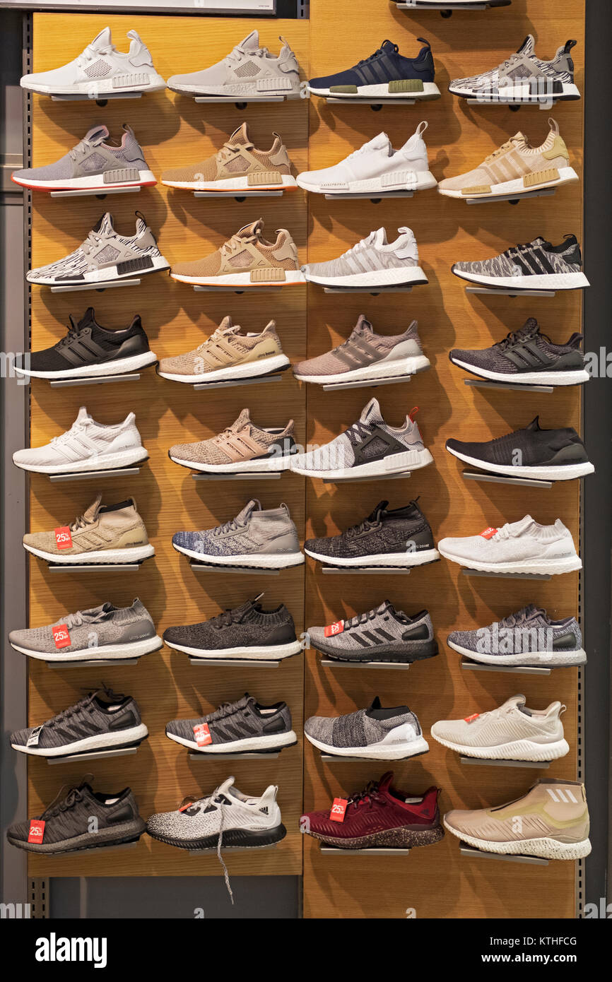 A display of Adidas athletic shoes for sale at the Footaction store ...