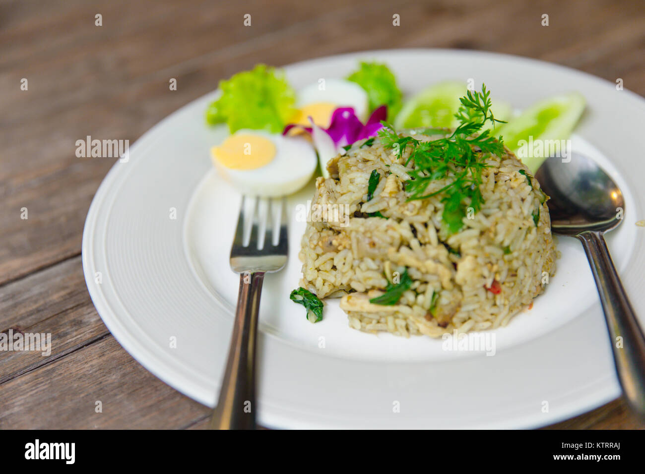 green curry fried rice recipe spicy and flavorful hot thai kitchen food on wood table - Hot Thai Kitchen