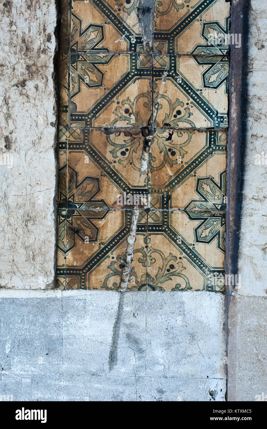 Antique ceramic tiles stock photos antique ceramic tiles stock old damaged portuguese azulejo ceramic tiles with a floral pattern decorate the external dailygadgetfo Choice Image