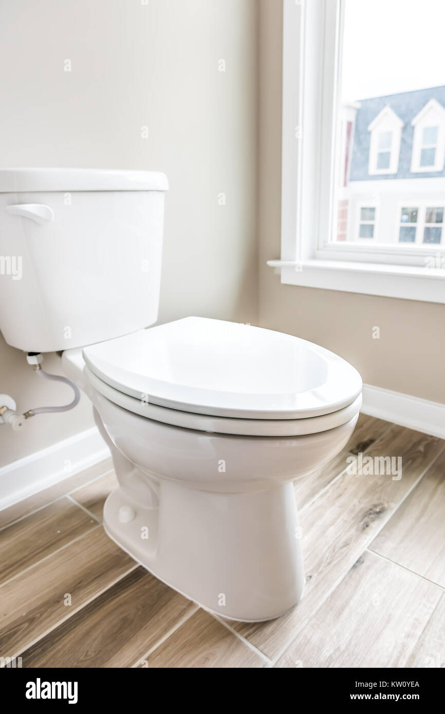 Minimalist Modern Clean White Toilet In Restroom With Window In