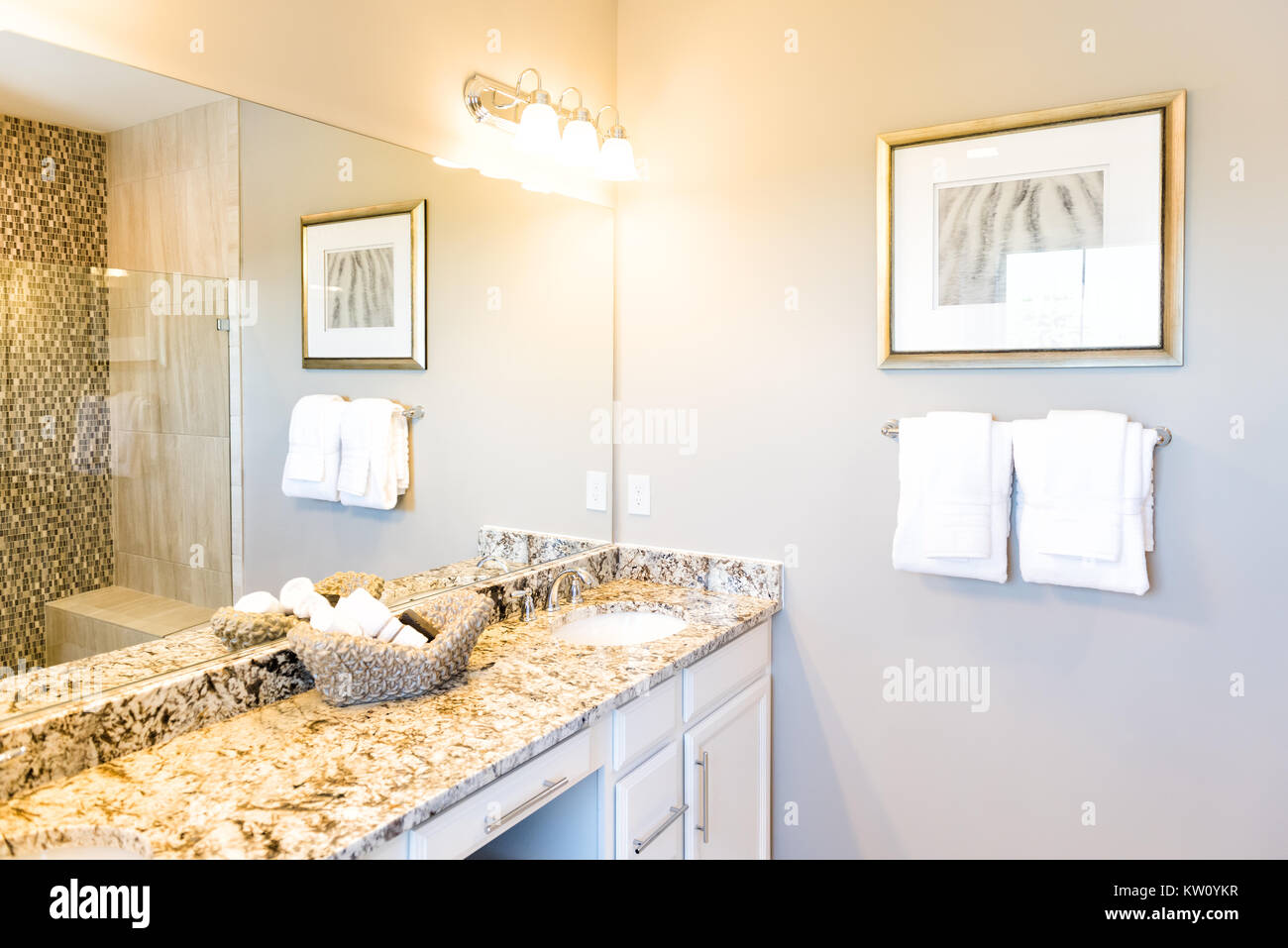 Hand Towels In Woven Basket In Bathroom Granite Countertop With Sink And  Mirror In Staging Model House Or Apartment, Reflection Of Shower