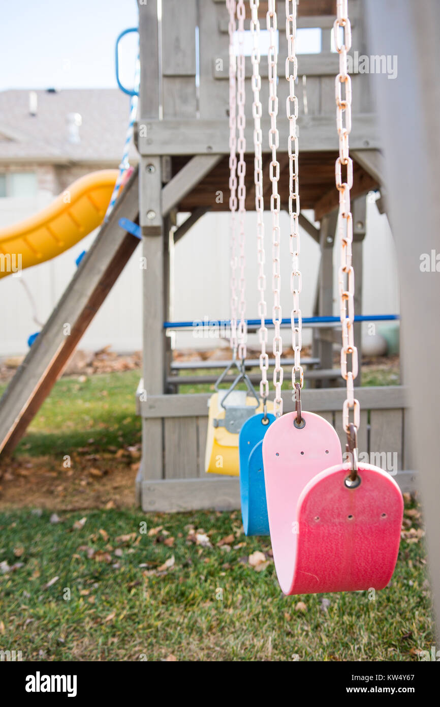 Backyard Play Structure brightly colored playground swings on backyard play structure stock