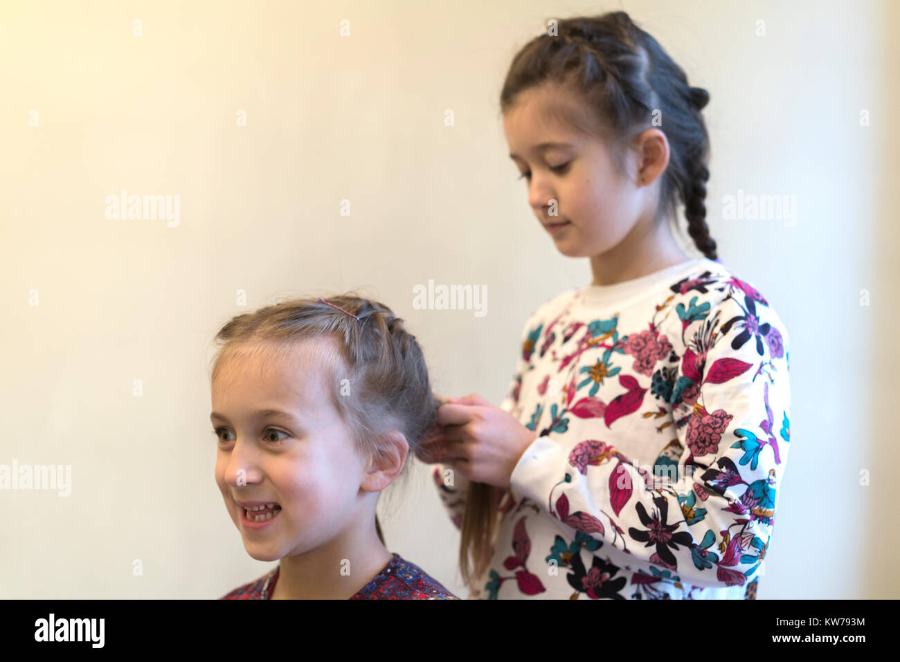 Little Girl Braids Her Sisters Hair Stock Photo 170420536 Alamy