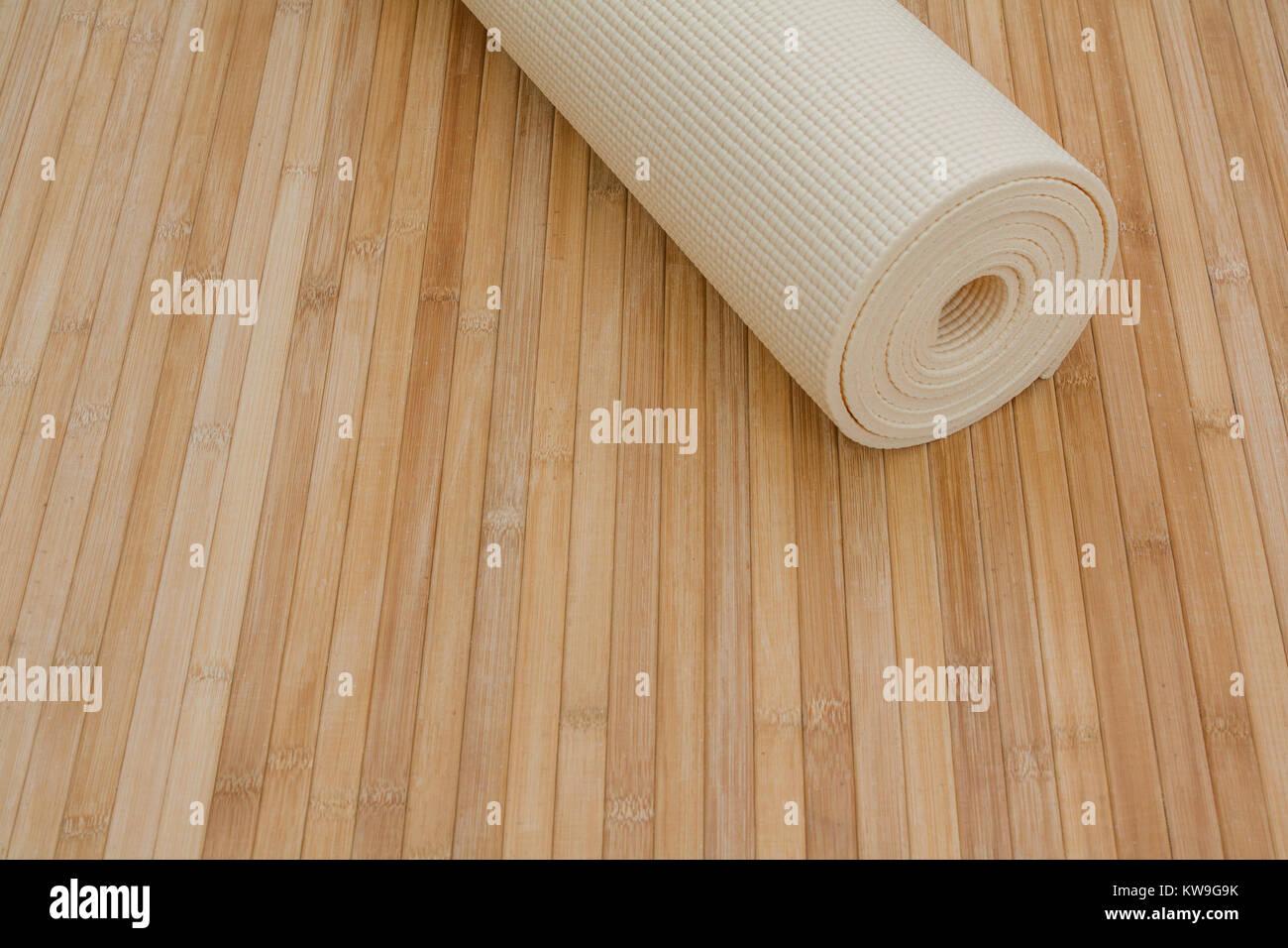 Yoga Class Supplies On Bamboo Mat Floor Ready For Yoga Retreat Stock