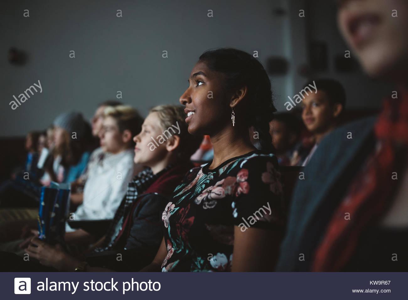 Indian tween girl watching movie in dark movie theater stock photo indian tween girl watching movie in dark movie theater altavistaventures Images