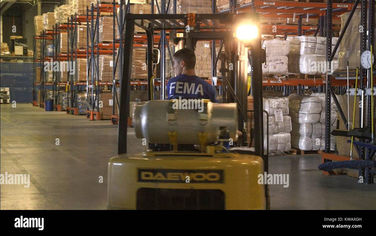 fema corp members loading water and cots into truck trailers at the atlanta distribution center in anticipation of hurricane matthew atlanta georgia