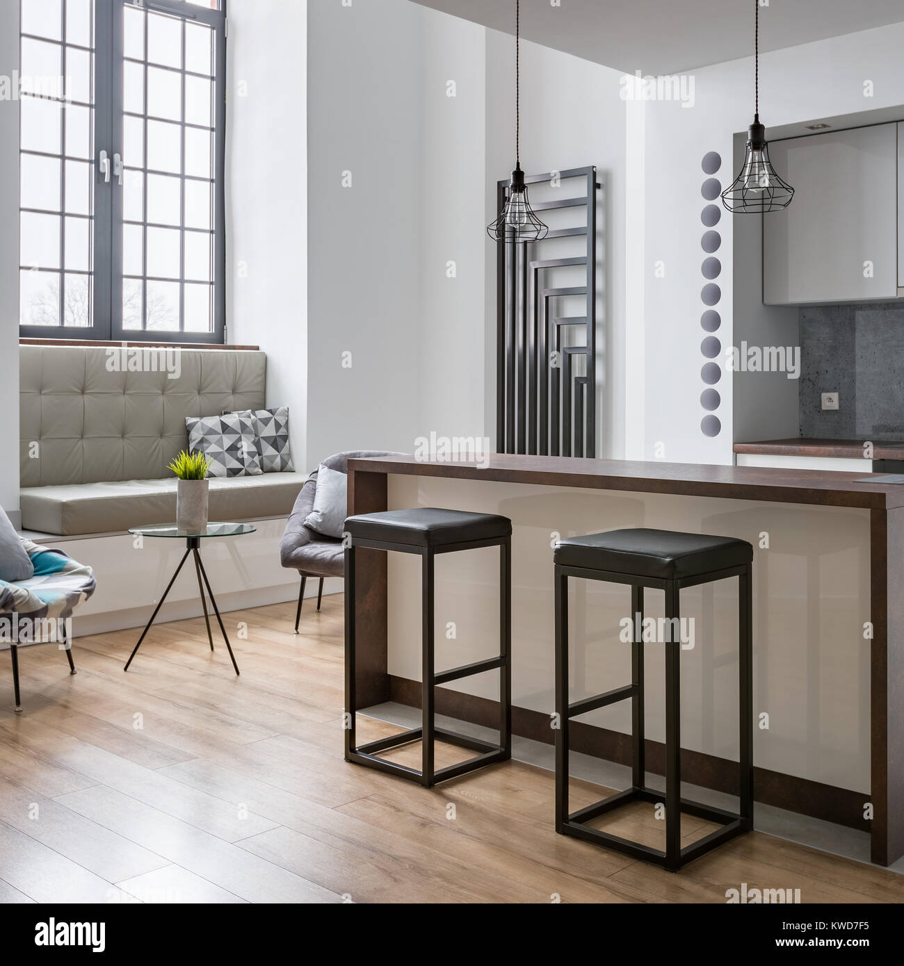 Interior with kitchen island bar stools and modern lamps