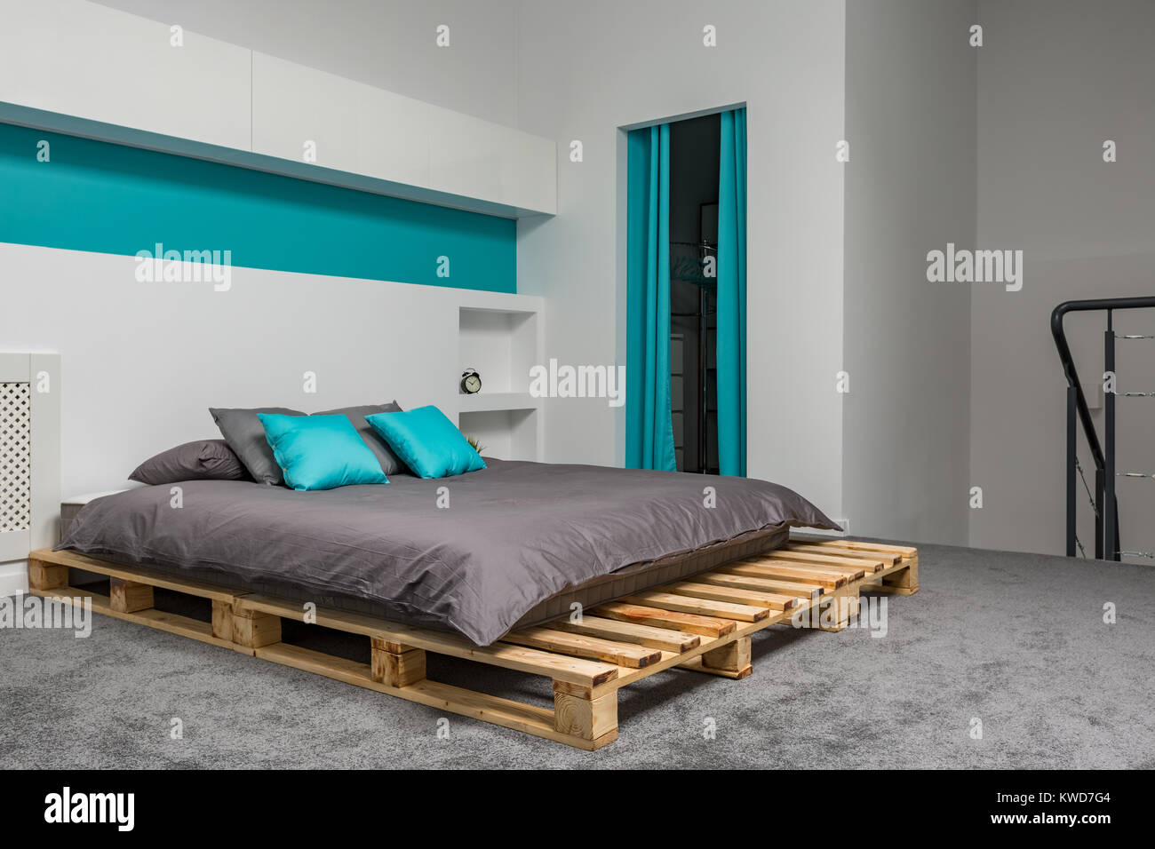 Bed Van Pallets : Bedroom with big pallet bed and turquoise details stock photo