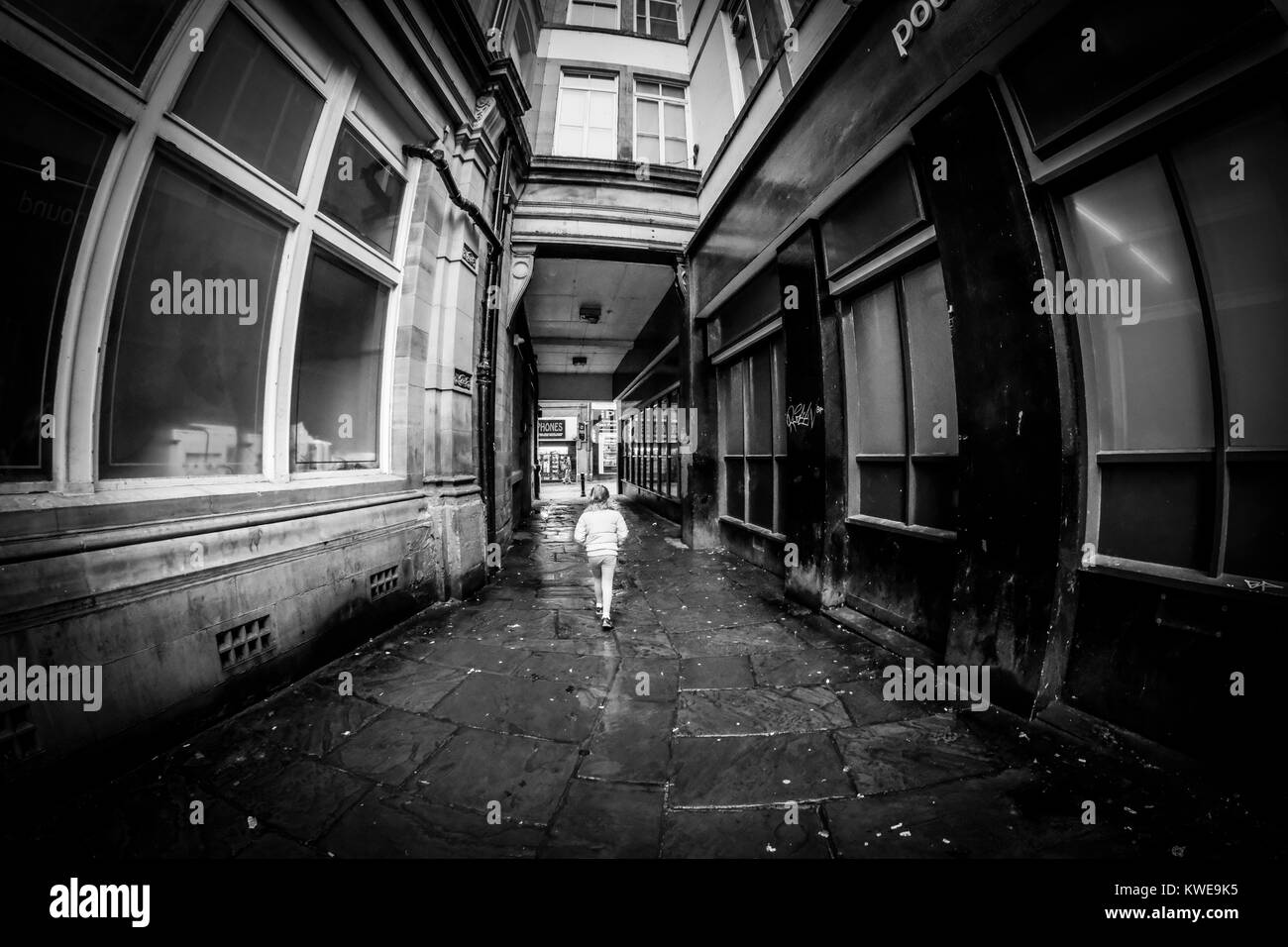 A Young Girl Walking Through Passage To Ivegate Bradford West Yorkshire England