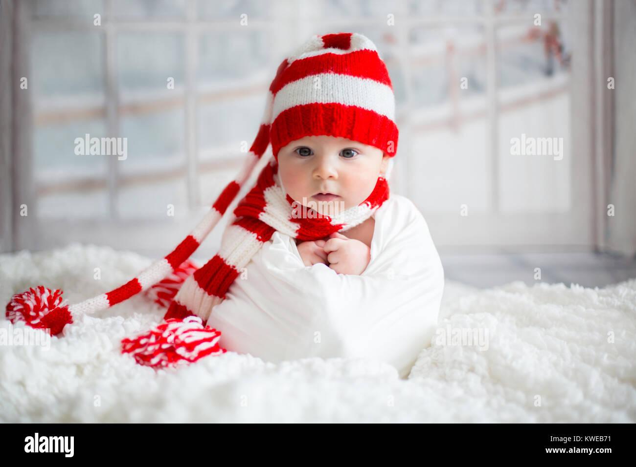 christmas portrait of cute little newborn baby boy, wearing santa