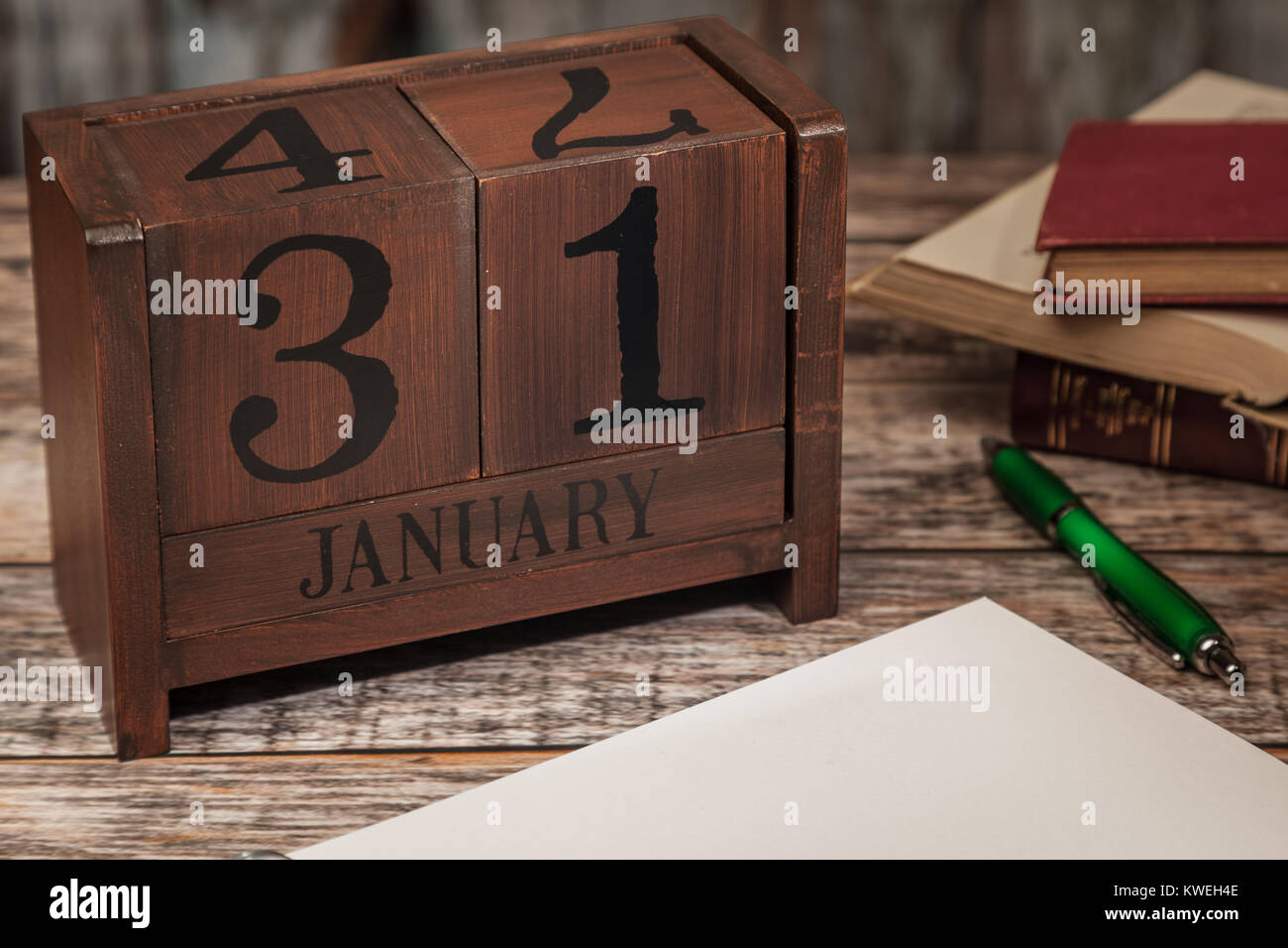 Perpetual Calendar In Desk Scene With Blank Diary Page January 31st