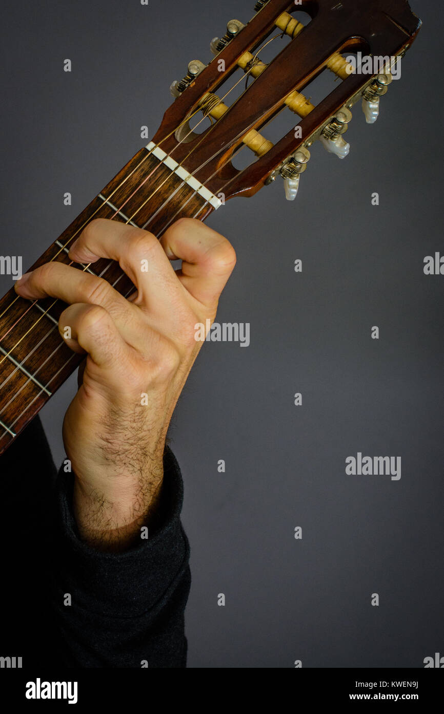 Guitarist Playing An G Major Chord On Classical Acoustic Guitar With