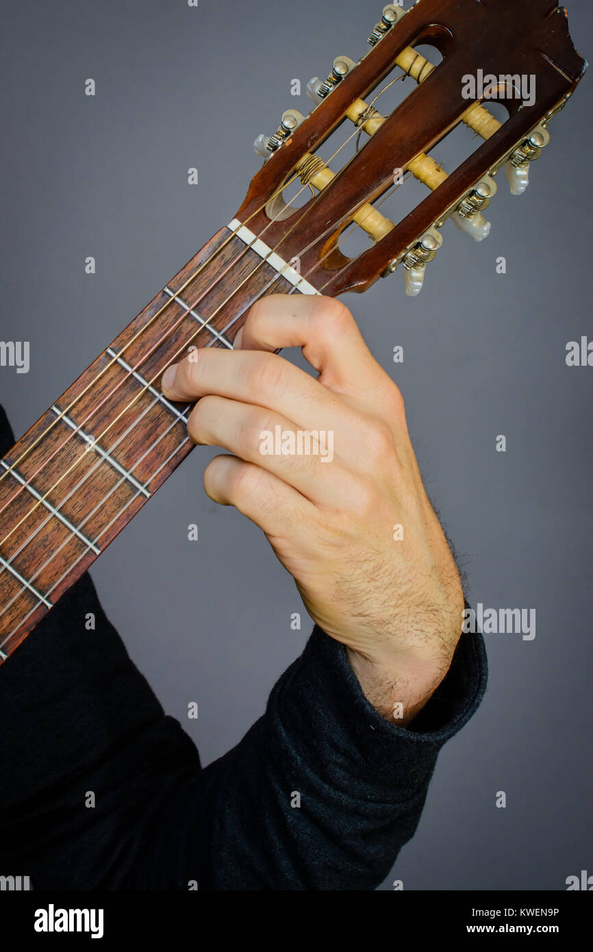Guitarist Playing An D Major 7 Chord On Classical Acoustic Guitar